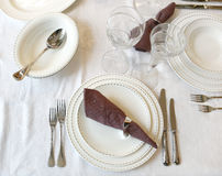 Table set. Knife, fork, spoon, plate and glasses on a table Stock Images