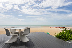 Table set with beach and sea. Wide scene of table set with beach and sea Royalty Free Stock Photos