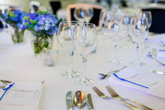 Table set in blue and white for wedding or event party. Royalty Free Stock Image