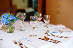 Table set in blue and white for wedding or event party. Stock Photos