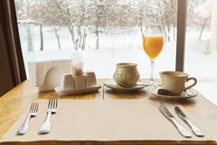 Table set for breakfast at restaurant stock photography