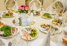 Table set for celebration in classic style with meal Royalty Free Stock Photography