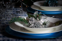Table set for christmas dinner with decoration blue and silver. With Christmas tree and set the mood for Christmas Stock Photos