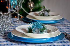 Table set for christmas dinner with decoration blue and silver. With Christmas tree and set the mood for Christmas Stock Images