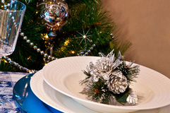 Table set for christmas dinner with decoration blue and silver. With Christmas tree and set the mood for Christmas Stock Image