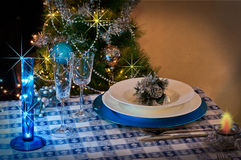 Table set for christmas dinner with decoration blue and silver. With Christmas tree and set the mood for Christmas Royalty Free Stock Image