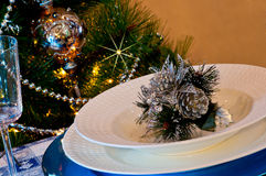 Table set for christmas dinner with decoration blue and silver. With Christmas tree and set the mood for Christmas Royalty Free Stock Photography