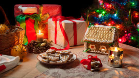 Table set with Christmas gifts. Closeup of a table set with Christmas gifts royalty free stock image