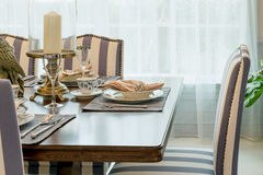 Table set in classic style dining room Stock Images