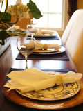 Table Set for Dinner. Closeup of three place settings with a bright window in the background Stock Image
