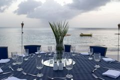 Table set for dinner on the beach Stock Photography