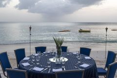 Table set for dinner on the beach Stock Photos