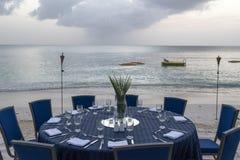 Table set for dinner on the beach Stock Photos