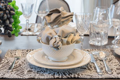 Table set for dinner on dinning table in luxury dinning room Stock Photos