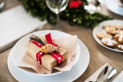 A table set for a dinner at home at Christmas time. A close-up of a table set for a dinner at home at Christmas time stock images