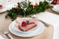 A table set for a dinner at home at Christmas time. A close-up of a table set for a dinner at home at Christmas time royalty free stock photo