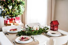 A table set for a dinner at home at Christmas time. A table set for a dinner for four people at home at Christmas time stock photo
