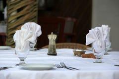 Table set for dinner on outside restaurant patio Stock Image