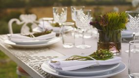 Table set for the dinner party. Table set for dinner party outdoors. Elegant table setting for a party stock footage