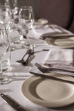 Table set for dinner service with white linen Royalty Free Stock Photography