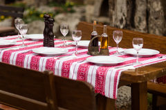 Table set with embroidered tablecloth Royalty Free Stock Image