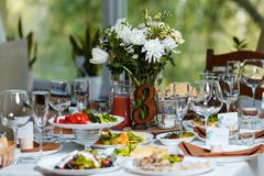 Table set for an event party or wedding reception.  Stock Images