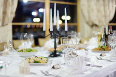 Table set for an event party or wedding reception. Table set for an event party or wedding Royalty Free Stock Image