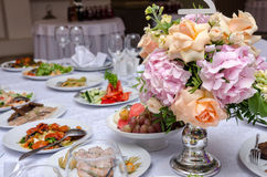 Table set for an event party or wedding reception. Banquet table in a restaurant Royalty Free Stock Photo