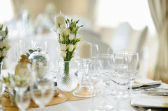 Table set for an event party or wedding reception. Beautiful table set for an event party or wedding reception Royalty Free Stock Images