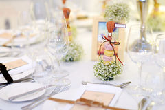 Table set for an event party or wedding reception. Beautiful table set for some festive event, party or wedding reception Stock Photography