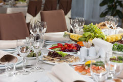 Table set for event party or wedding reception celebration. Table setting with food for reception, weddings, celebration Stock Photo