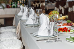 Table set for event party or wedding reception celebration. Table setting with food for reception, weddings, celebration Royalty Free Stock Photo