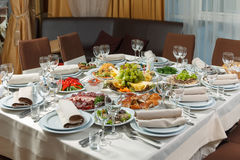 Table set for event party or wedding reception celebration. Table setting with food for reception, weddings, celebration Royalty Free Stock Photography