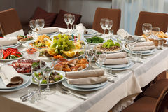 Table set for event party or wedding reception celebration. Table setting with food for reception, weddings, celebration Royalty Free Stock Photos