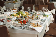 Table set for event party or wedding reception celebration. Table setting with food for reception, weddings, celebration Stock Photography