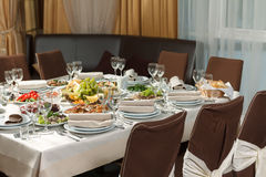 Table set for event party or wedding reception celebration. Table setting with food for reception, weddings, celebration Stock Photos