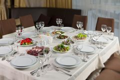 Table set for event party or wedding reception. Elaborate table setting at a reception Stock Photography