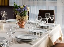 Table set for event party or wedding reception. Elaborate table setting at a reception Stock Photos
