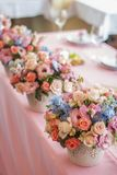 Table set for an event party or wedding reception. Flowers on table Stock Image