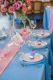 Table set for an event party or wedding reception. Flowers on table Stock Photos
