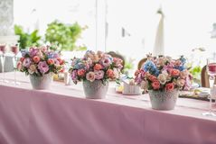Table set for an event party or wedding reception. Flowers on table Stock Photography