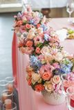Table set for an event party or wedding reception. Flowers on table Royalty Free Stock Images