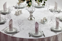 Table set for an event party or wedding reception. In a restaurant Royalty Free Stock Photo