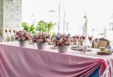 Table set for an event party or wedding reception. Flowers on table Royalty Free Stock Photo