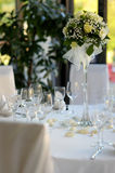 Table set for a festive party or dinner. With a yellow rose Royalty Free Stock Photo