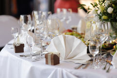 Table set for a festive party or dinner. With a brown box Royalty Free Stock Photos