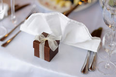 Table set for a festive party or dinner. With a brown box Stock Photos