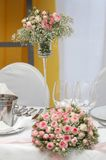 Table set for fine dining. During a wedding event. Shallow depth of field, focus on the bouquet of flowers Royalty Free Stock Photos