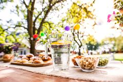 Table set for a garden party or celebration outside. Table set for a garden party or celebration outside in the backyard Royalty Free Stock Photos