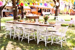 Table set for a garden party or celebration outside. Royalty Free Stock Images